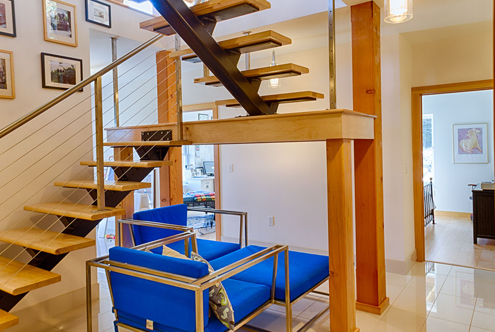 floating stairs lead into finished basement