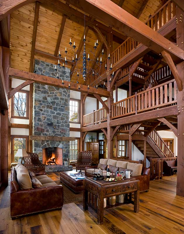 cozy timber frame great room with stone fireplace