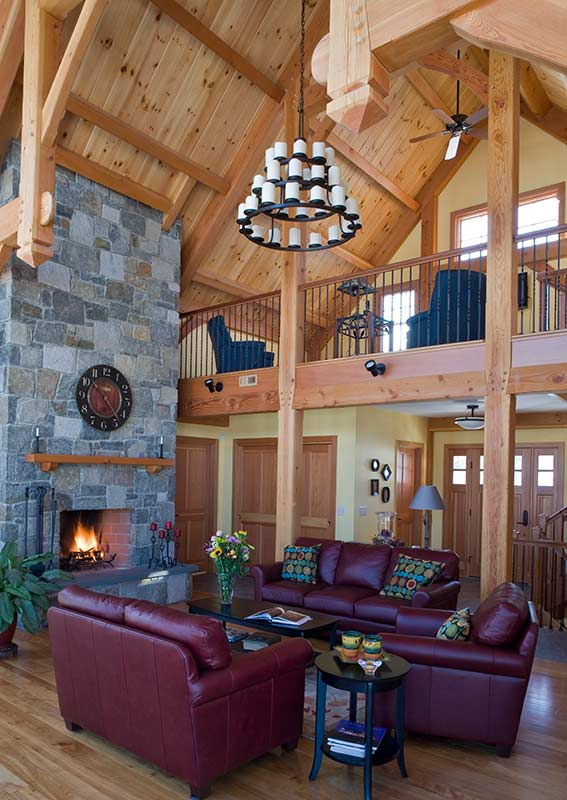 timber frame great room with stone fireplace