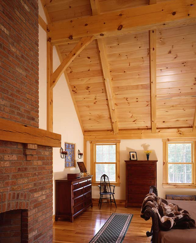 timber frame bedroom with fireplace