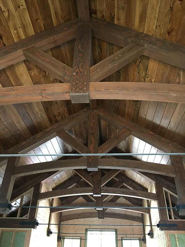 stained timber frame trusses