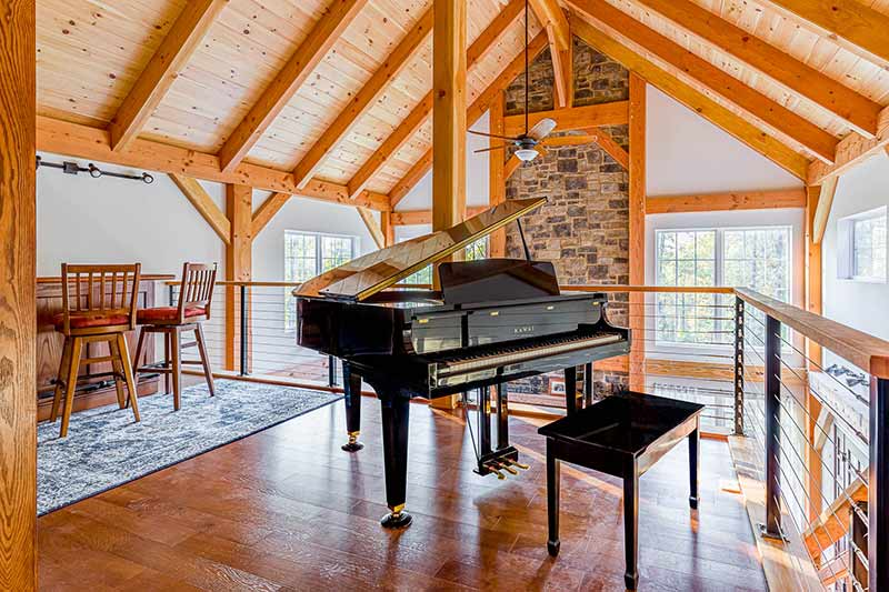 timber frame loft with piano