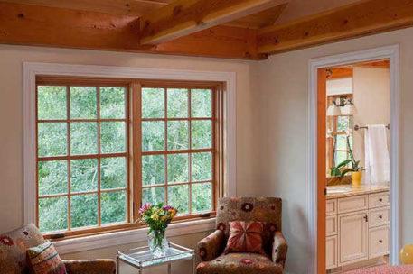 Vaulted ceiling timber frame bedroom