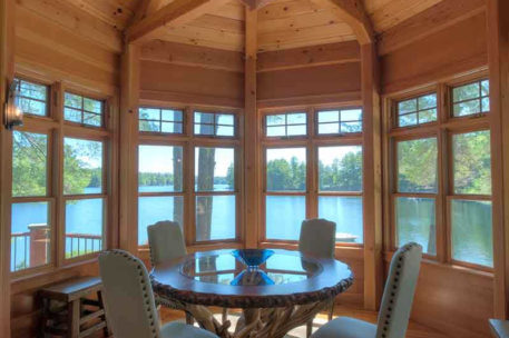 Lakeside New Hampshire panelized home with octagon timber frame porch