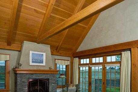 Vaulted ceiling timber frame master bedroom
