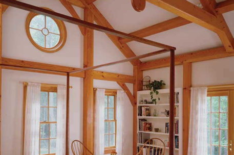 Vaulted timber frame bedroom in Vermont