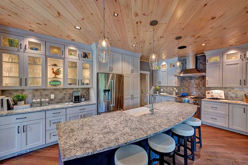 hybrid lakeside timber frame home with conventional kitchen