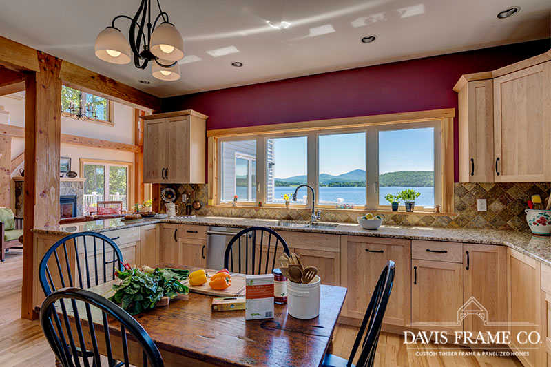 hybrid timber frame home with conventional kitchen and natural wood cabinets